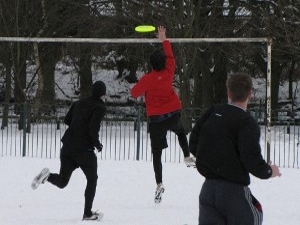 Stevie catches an Ultimate Frisbee point in the snow, Didsbury, Manchester